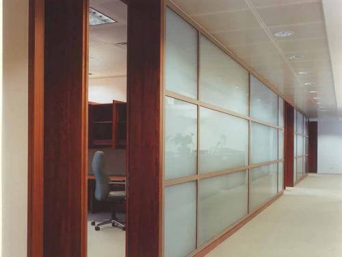 Glass partition system with bespoke joinery
