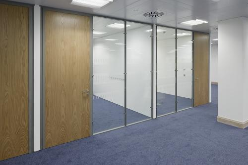 Flush glazed office fronts with timber door
