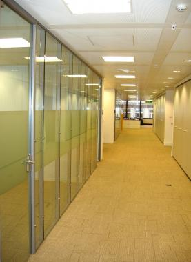 Flush glazed partiton system with glass doors